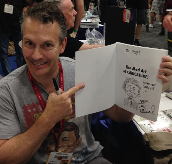 Tom Richmond, Mad Magazine caricaturist, with Signed and Caricatured Book at Comic-Con