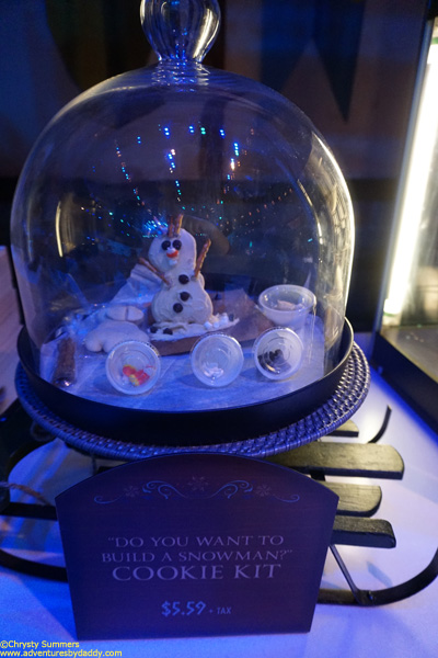 Several Frozen themed snacks are available exclusively inside Olaf's Snow Fest, including this Build Your Own Snowman cookie kit.