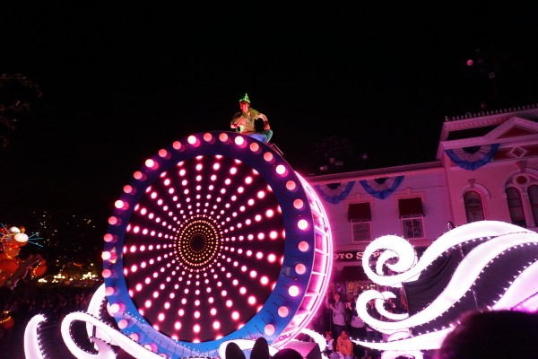 Tink is followed by Peter Pan, who sits atop a giant float that introduces the Paint the Night Electrical Parade (photo by Chrysty Summers)